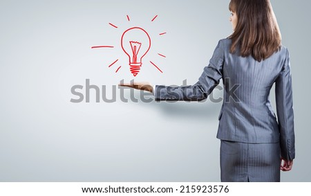 Close up of businesswoman hand with bulb in palm