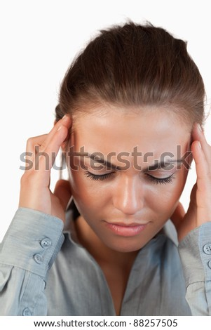 Close up of businesswoman having a headache against a white background