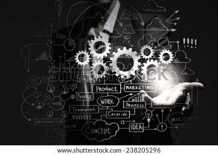 Close up of businesswoman holding gears in hand - stock photo