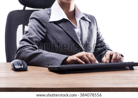 Close-up of businesswoman using computer keyboard.