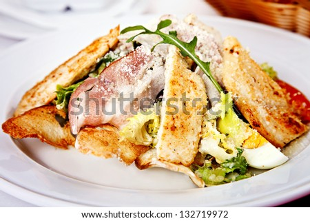 Close up of Caesar salad served on plate - stock photo