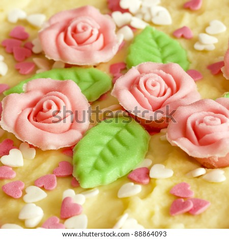 close up of cake with marzipan roses - stock photo