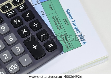 Close up of calculator and sales target plan on desk.business concept - stock photo