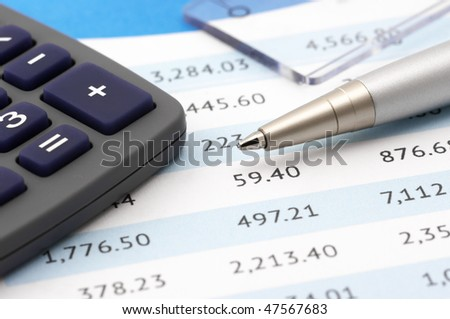 Close-up of calculator, pen and rule on paper table. - stock photo