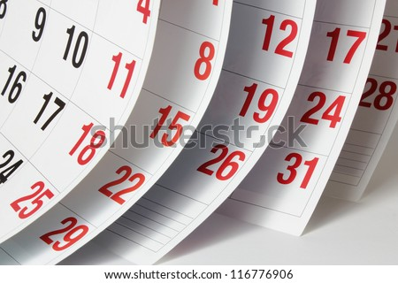 Close Up of Calendar Pages - stock photo