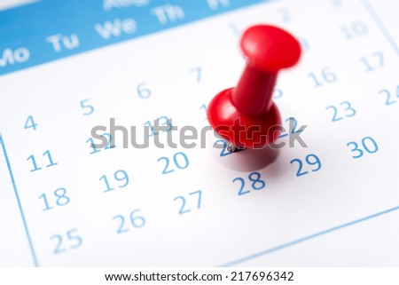 Close up of calendar pinned with thumbtack - stock photo