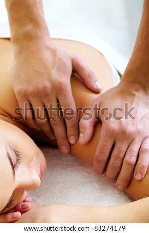 Close-up of calm female during luxurious procedure of massage - stock photo