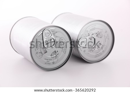 Close-up of cans with open method illustrations on white background. - stock photo