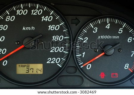 Close up of car dashboard with speed and rpm dials - stock photo