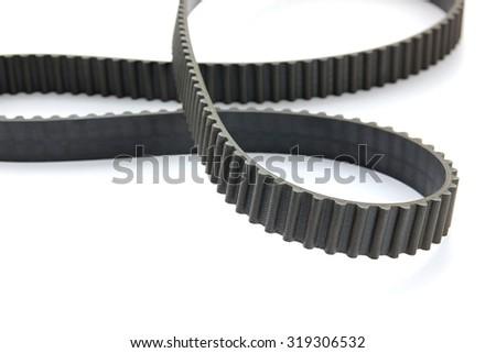 Close-up of car's engine belt on white background. - stock photo