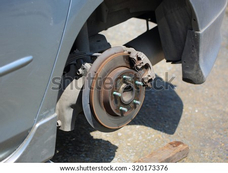 close up of car wheel tire replacement, car's break assembly after repair