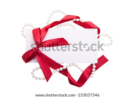 Close up of card note with red ribbon isolated on white background - stock photo