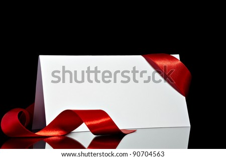 close up of  card note with  ribbon on black background - stock photo