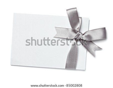 close up of  card note with  ribbon on white background  with clipping path - stock photo