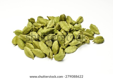 Close up of cardamon pods on white background - stock photo