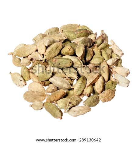 Close-up of cardamon pods on white background. - stock photo