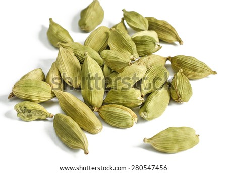 Close up of cardamon pods on white background. Selective focus - stock photo