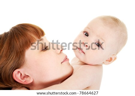 Close-up of careful mummy with her baby on white background - stock photo