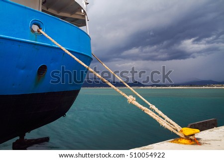 Close up of cargo ship fixed with a rope at bollard, Argolic Gulf,  Nafplion (Nafplio), Greece