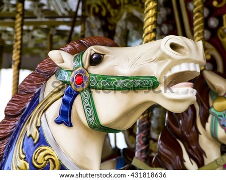 Close-up of carousel horse; wild stallionâ??s head on funfair roundabout  - stock photo
