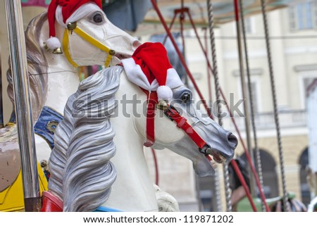Close up of carousel horse with santa hat