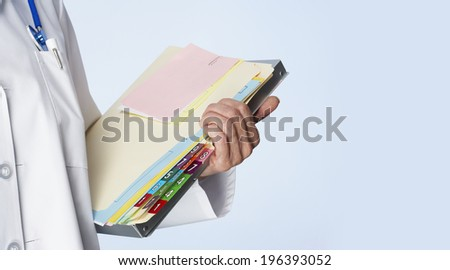 Close-up of carrying books - stock photo