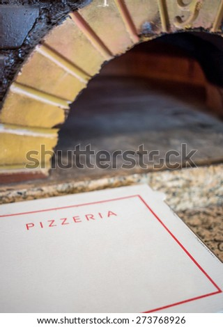 Close up of carton box for pizza next to an oven - stock photo