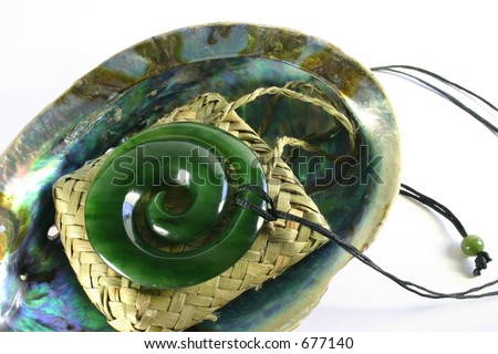 Close up of carved maori nephrite jade / greenstone pendant - stock photo