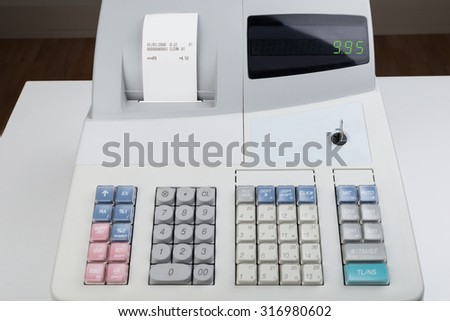 Close-up Of Cash Register With Printed Receipt - stock photo
