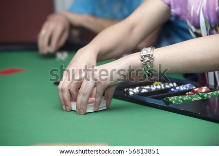 close up of casino cards and chips - stock photo
