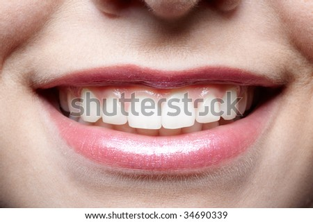 close up of causasian girl's mouth zone