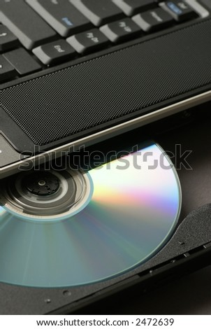 Close-up of CD in laptop