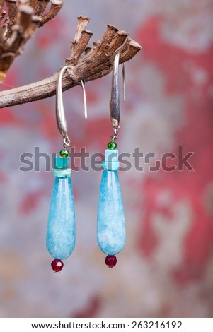 Close up of chalcedony earrings, manufactured by Ornella Salamone - stock photo