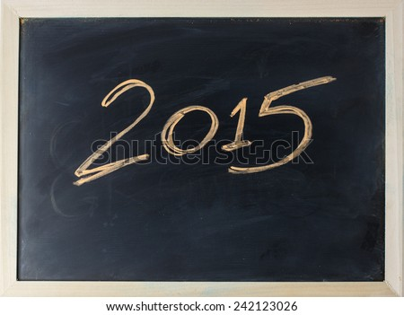 close up of chalkboard with new year 2015 - stock photo