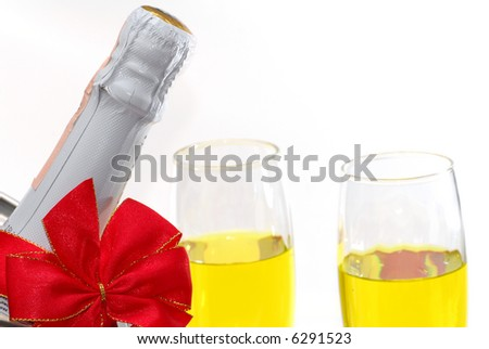 Close-up of champagne bottle decorated for christmas - stock photo