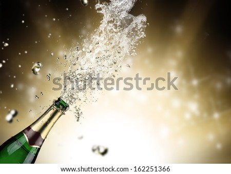 Close-up of champagne explosion. Celebration theme. - stock photo