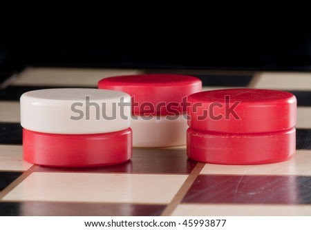 Close up of checkers on a game board - stock photo