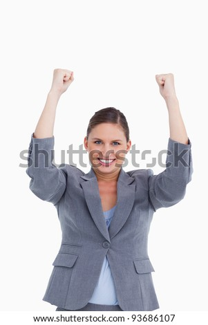 Close up of cheering tradeswoman against a white background