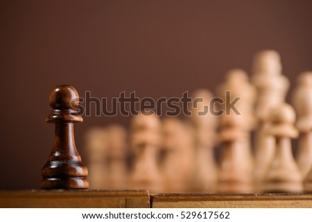 close up of chess piece pawn on chessboard