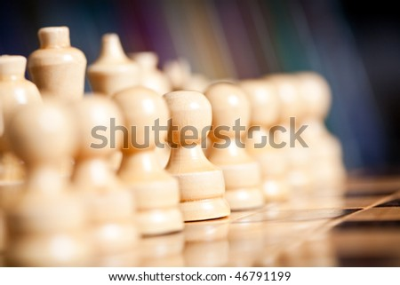 Close up of chess pieces on the board, shallow depth of field