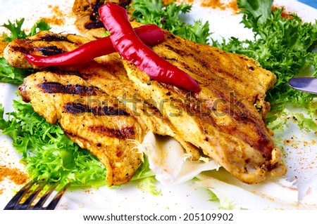 Close up of chiken BBQ with peppers and lettuce - stock photo