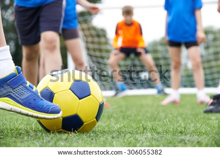 Close Up Of Children's Feet In Soccer Match - stock photo