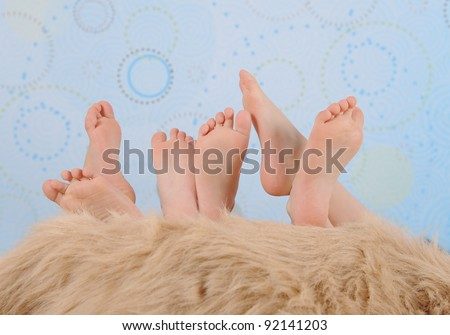 close-up of children's feet over furry blanket - stock photo