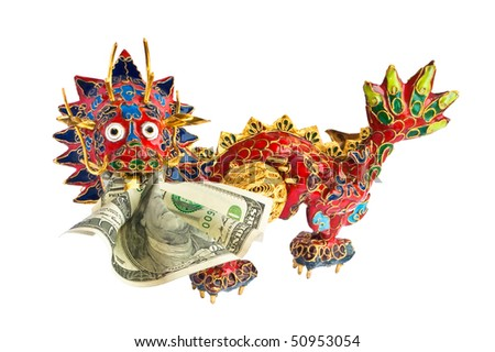 Close-up of Chinese enameled dragon with American dollar in mouth. Dragon devours dollar. - stock photo