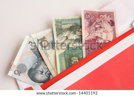 Close up of Chinese money in red envelope - stock photo