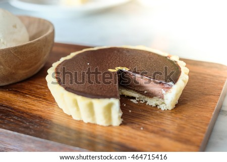 Close up of Chocolate Tart with Vanilla Ice Cream with warm lighting effect