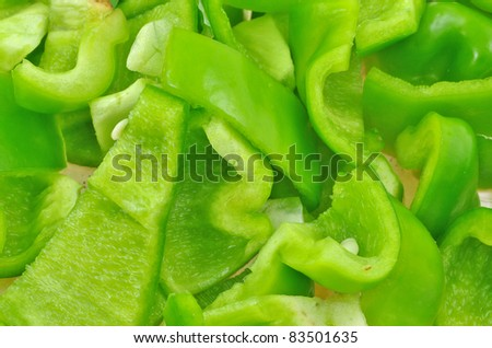 close up of chopped pieces of green capsicum