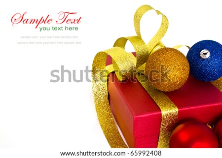 Close up of christmas gift box and christmas balls on white background with copy space. - stock photo