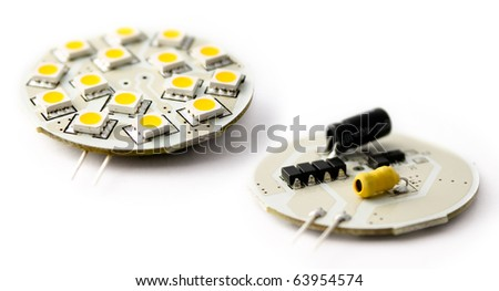 Close-up of circuitry belonging to a LED light bulb. - stock photo
