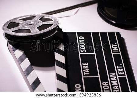 Close-up of clap cinema, metal or plastic reel of film. Objects for shooting movies and demonstrations - stock photo